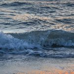 Free stock photo Close up of a wave breaking on the shore line