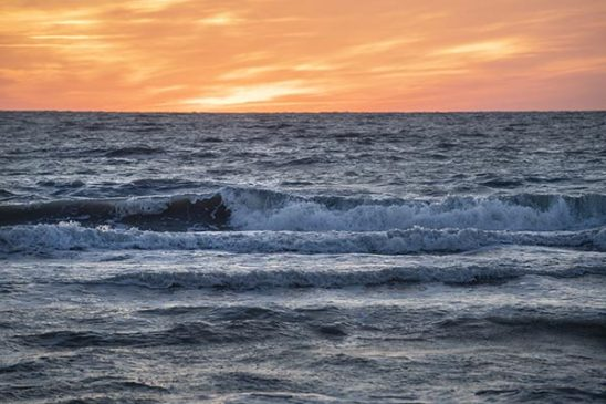 Free stock photo Ocean waves against a sunset sky