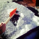 Free stock photo Brushing away snow from a car windshield