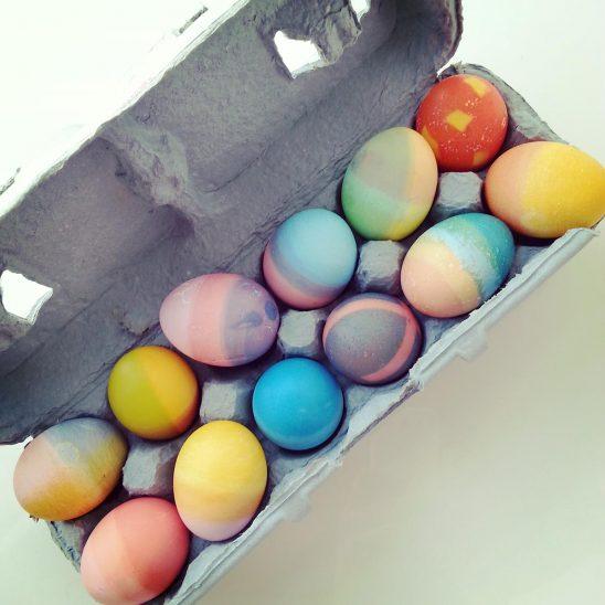 Free stock photo A dozen colored Easter eggs in an egg carton