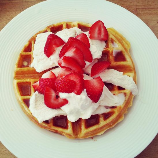 Free stock photo Waffle on a plate with ice cream and strawberries