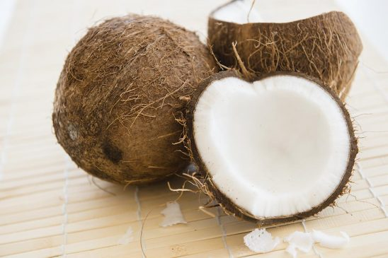 Free stock photo Open coconut on a bamboo mat