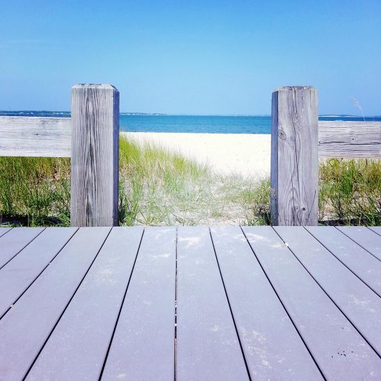Free stock photo Looking at a beach from a boardwalk