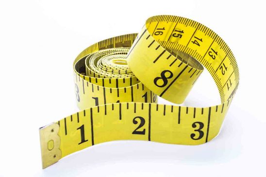 Free stock photo Close-up of measuring tape over white background