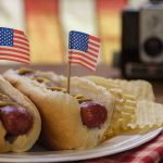 Free stock photo Close-up of american flags on hot dogs