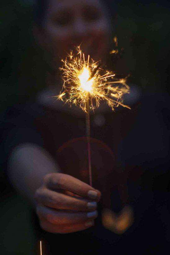 Free stock photo Woman holding sparkler