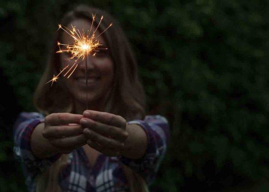 Free stock photo Smiling woman holding sparkler