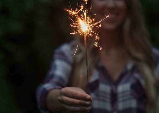 Free stock photo Midsection of woman holding sparkler