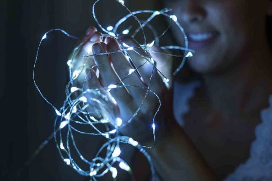 Free stock photo Close-up of hands holding strand of lights