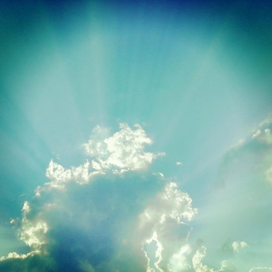 Free stock photo Sunrays bursting out from behind clouds
