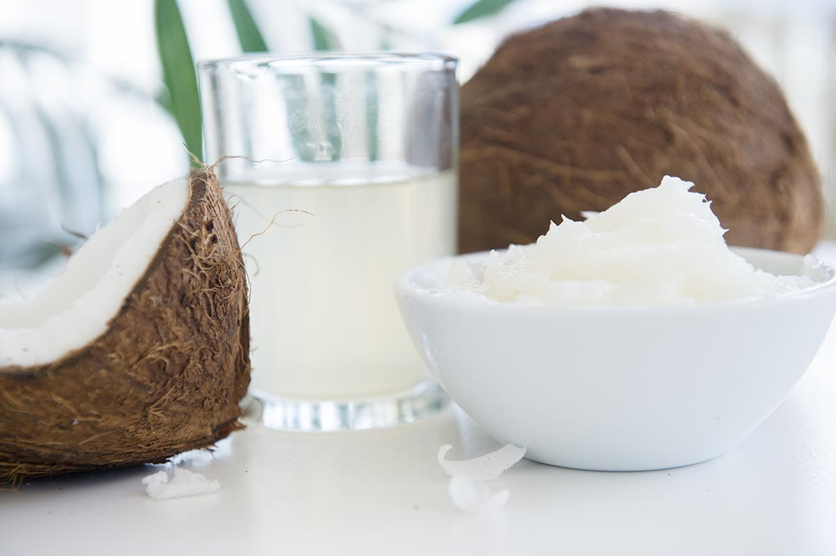Free stock photo Coconut milk and meat with an open coconut