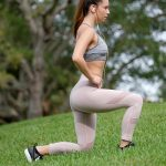 Free stock photo Profile view of a woman exercising with lunges on a lawn
