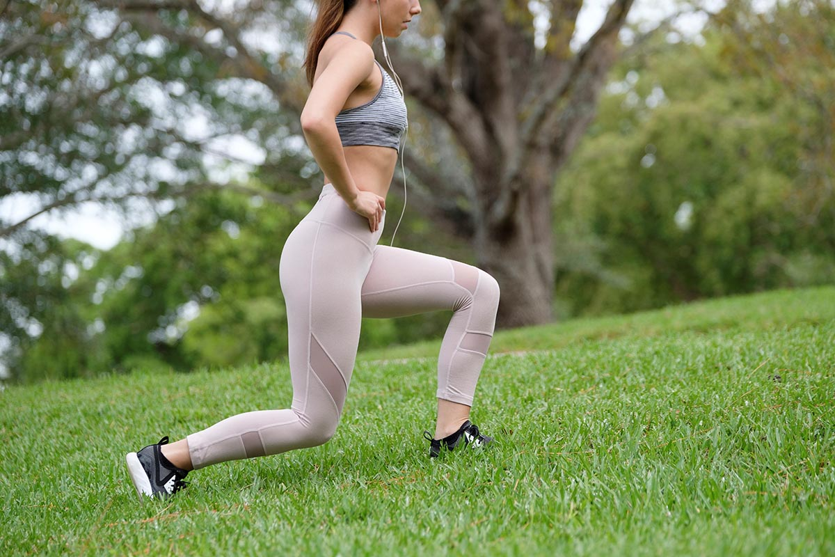 Free stock photo Partial view of a woman exercising with lunges