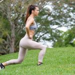 Free stock photo Woman exercising on a lawn
