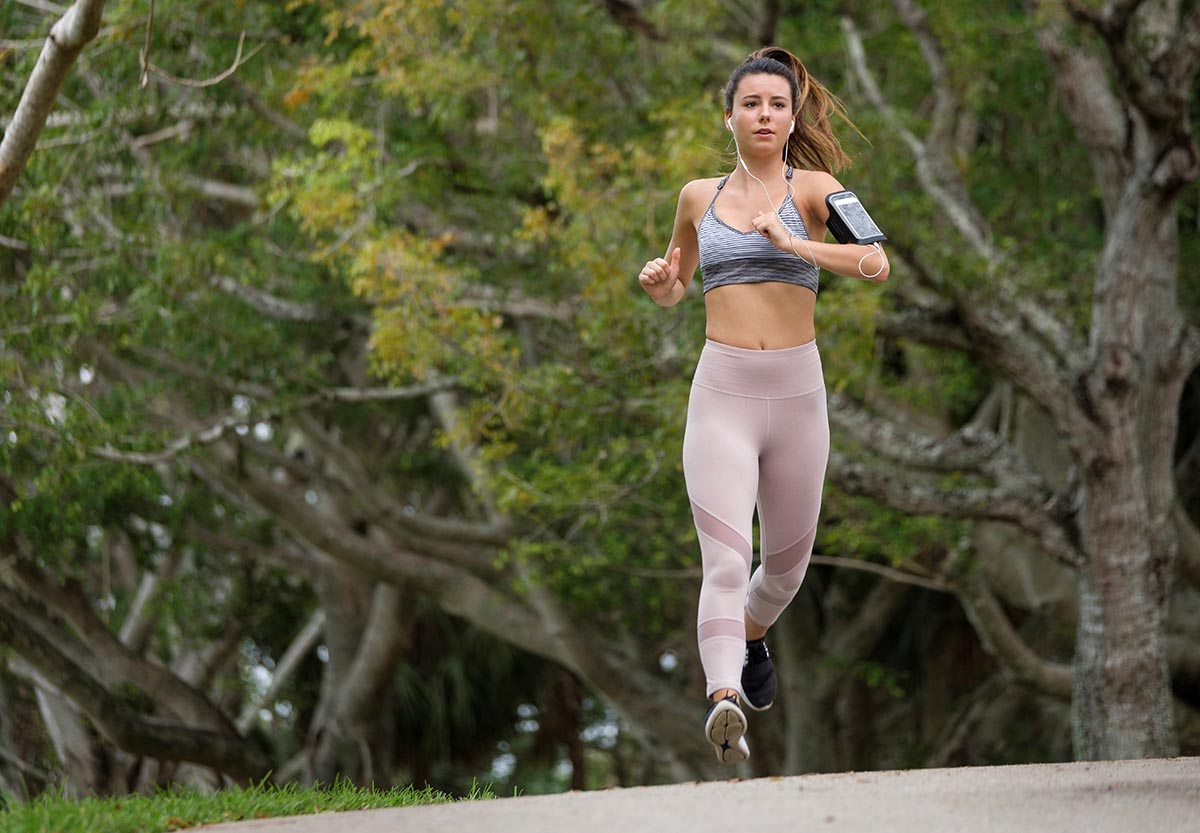 Free stock photo Woman jogger running towards the camera
