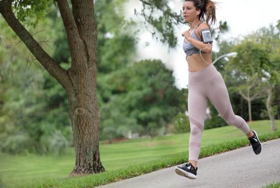 Free stock photo Woman jogging and listening to music