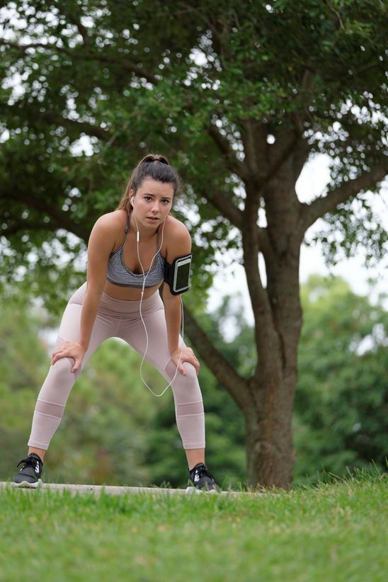 Free stock photo Young woman pausing to rest after jogging