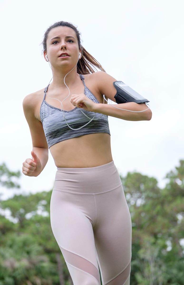 Free stock photo Close up of a young woman jogger from a low angle