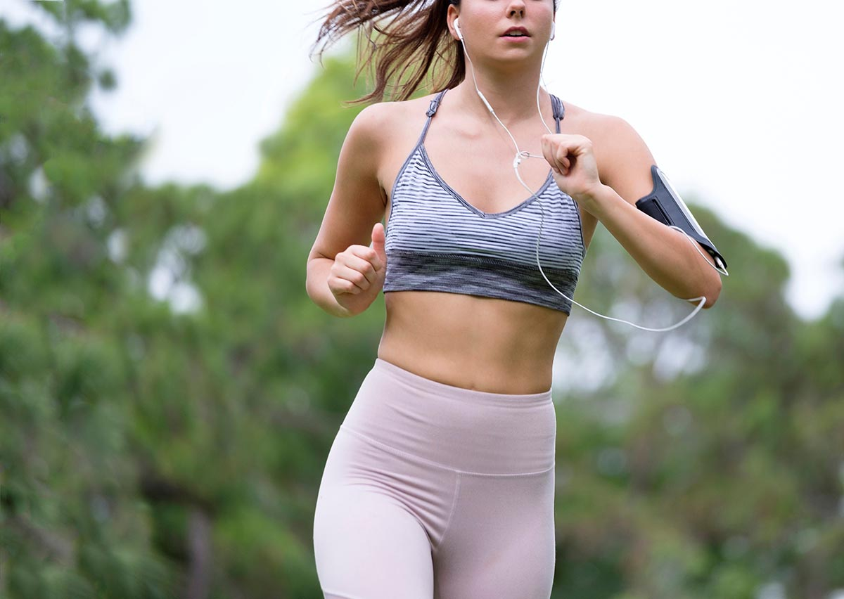 Free stock photo Partial view of a young woman jogging outdoors