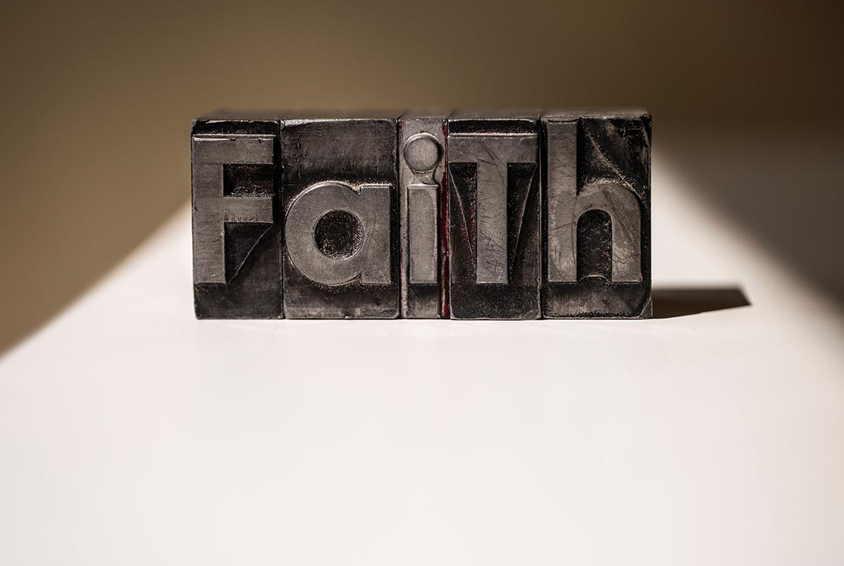Free stock photo The word Faith spelled out in metal type fonts