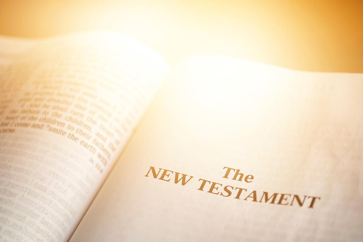Free stock photo Bible opened to the New Testament title page