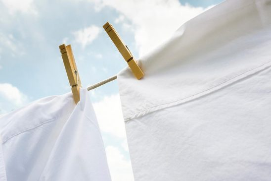 Free stock photo Close pins holding up white cloth to dry on a clothesline