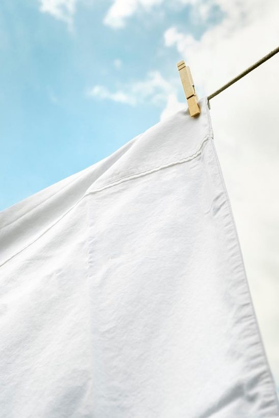Free stock photo White sheet hanging on a clothesline to dry