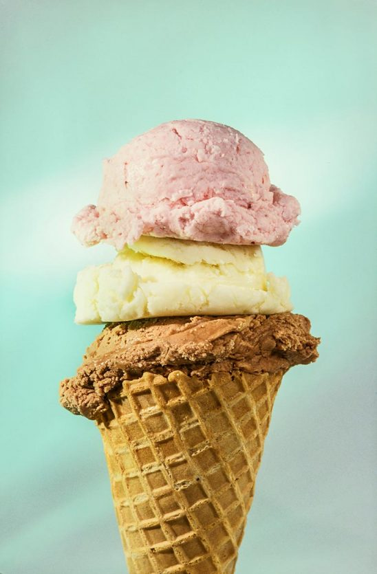 Free stock photo Triple scoop ice cream cone of chocolate, vanilla, and strawberry