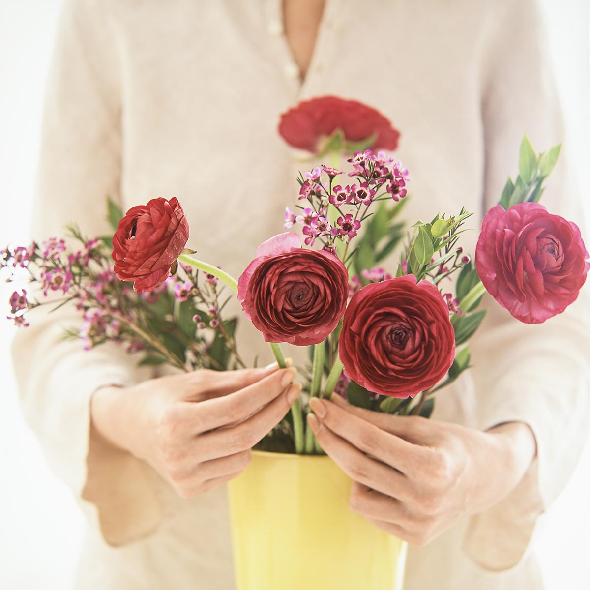 Free stock photo Woman's hands arranging flowers in a vase