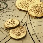Free stock photo Old gold coins on a world map
