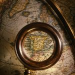 Free stock photo Magnifying glass showing part of an antique globe