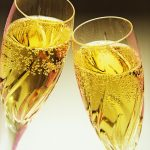 Free stock photo Two full champagne glasses toasting