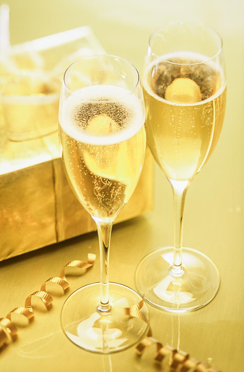 Free stock photo Two full champagne glasses with celebrating with a present