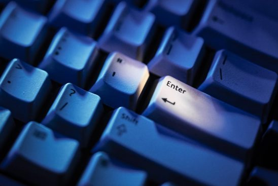 Free stock photo Blue background close of Enter key on a keyboard
