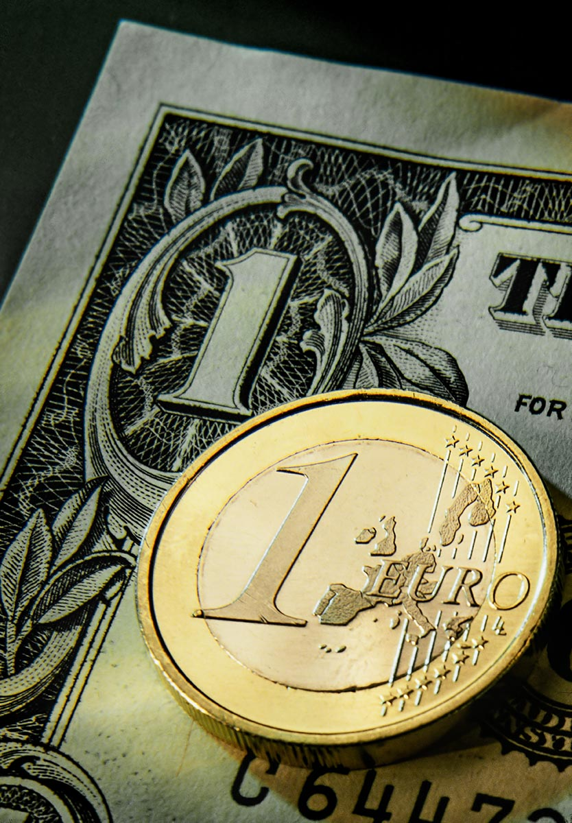 Free stock photo Close up of a Euro coin and one dollar bill