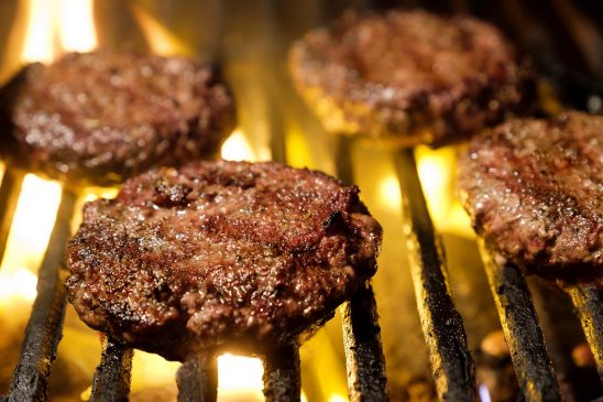 Free stock photo Hamburgers cooking on a charcoal grill