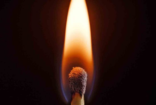 Free stock photo Close-up of burning matchstick over black background