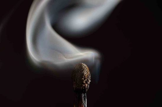 Free stock photo Close-up of extinguished matchstick over black background