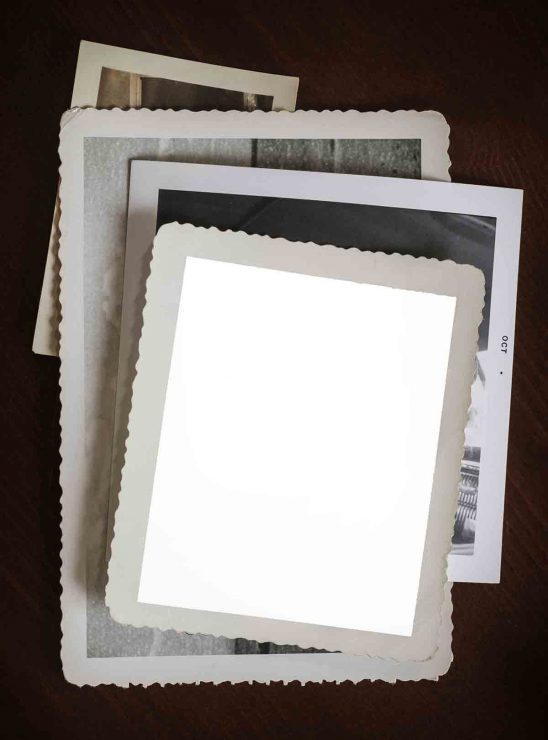 Free stock photo High angle view of blank photograph on table