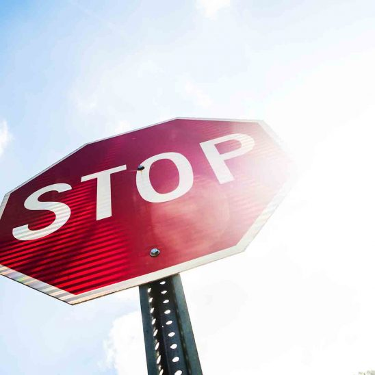 Free stock photo Low angle view of red stop sign against sky