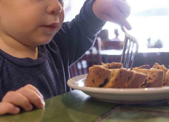 Free stock photo Close-up of boy having cake at table