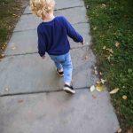 Free stock photo Rear view of boy walking on sidewalk