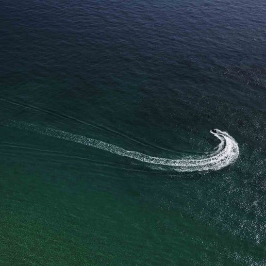 Free stock photo Aerial view of cabin cruiser turning in sea