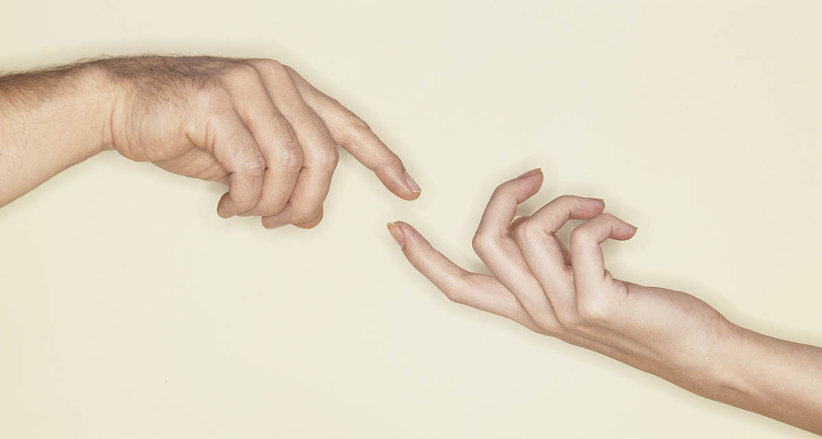 Free stock photo Hands of a man and woman with fingers about to touch