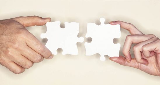 Free stock photo Hands of a man and woman matching puzzle pieces