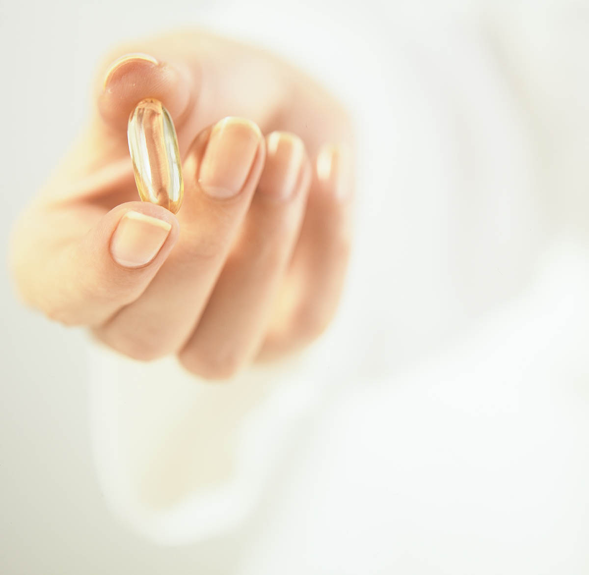 Free stock photo Woman's hand holding a vitamin pill