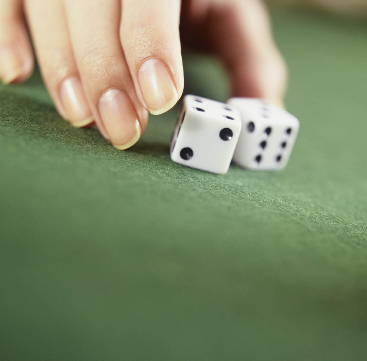 Free stock photo Woman's hand rolling dice