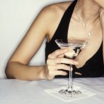 Free stock photo Woman in a black evening dress holding a martini
