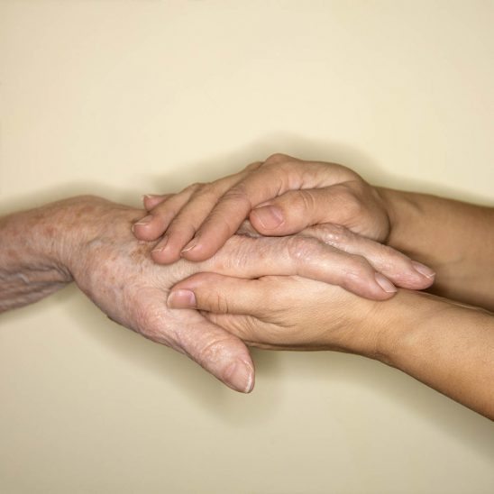 Free stock photo Woman's hands comforting an older man's hand