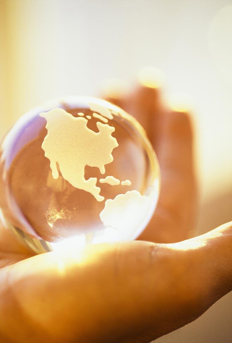 Free stock photo Hand holding a glass world globe